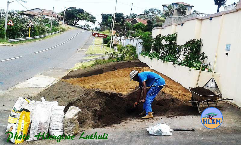Busy spreading five cubic meters of Living Earth compost which is to be incorporated into the soil HLEM Hlengiwe Luthuli Environmental Management (Pty) Ltd KZN Durban South Africa